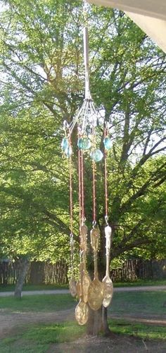 Hammer old silver spoons flat, make your own windchime.  I have one made from old forks hung from one fork with all its tines twisted out to hold the strings. Sounds good too!