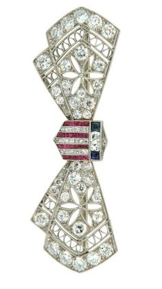 Early 1900s Black Starr & Frost Ruby Sapphire Diamond Platinum Patriotic Brooch. A wonderful example of World War 1 era, Americana jewelry by Black Starr & Frost. This beautiful brooch is crafted from platinum and set with diamonds, rubies, and sapphires.