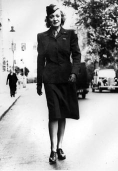Marlene Dietrich entertained the troops in Europe during World War II. Here's an AP photo Sept. 28, 1944 of the actress/singer walking down the street in London wearing a Women's Army Corps uniform, which was also worn by female USO camp show performers, only the patches on the uniform and the garrison cap are different ~