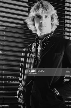 Stewart Copeland, drummer with British rock band The Police poses in front of a window covered by a venetian blind in a studio portrait, United Kingdom, circa 1979.
