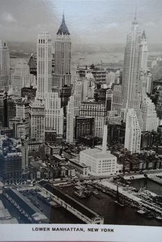New York is the only real city-city. Truman Capote. And there it is in all its glory laid out before you in this 1930s aerial view photo postcard. The person who mailed it could have bought it in Germany or New York, as it was printed in Germany. Maybe, if the buyer was in New York, he had to hurry to catch his ship because the postcard was mailed in Germany using two burgundy Reichsmark postage stamps. You can almost see him as he turns the collar of his overcoat up, struggling along with…