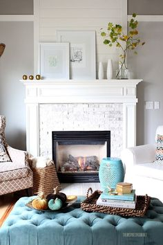 beautiful white mantel arrangement