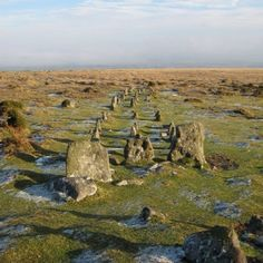 Okehampton, England — by Rich Smith. Neolithic cairn and triple stone row/ avenue on Dartmoor located on the lower eastern slope of Cosdon Hill