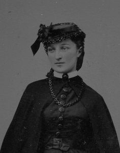 1860s woman wearing mourning dress and mourning jewelry.