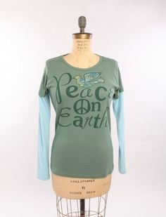 Peace on Earth Double-Up tee. Our double-up gives the appearance of the layered look in one easy shirt. Made from 100% organic cotton. Knit, cut and sewn in the USA. http://www.green3apparel.com/holiday/peace-on-earth-double-up/ $27.99