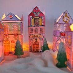 Create these Christmas Village Lanterns using paper and a glass jar (in Swedish and English).