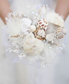 Wedding bridal bouquet can be made with flowers such as roses and violets, lilies and orchids, peonies and daisies, freesia and chrysanthemums, daisies and lisianthuses. In this article we will look in detail at classic and unusual wedding bouquets. Seashell Bouquet, Seashell Wedding, Seaside Wedding, Mermaid Wedding, Beach Wedding Bouquets, Wedding Flowers, Bridal Bouquets, Marie, Wedding Planning