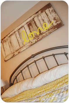 Old door used as decor above a bed... or could be used MANY places in the house! Love this!