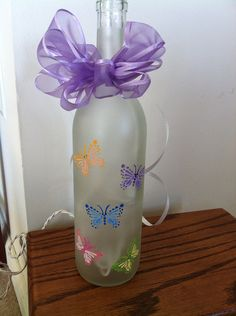 Items similar to Butterfly Wine Bottle on Etsy Recycled Wine Bottles, Wine Bottle Art, Glass Bottle Crafts, Painted Wine Bottles, Lighted Wine Bottles, Diy Bottle, Wine Glass, Bottle Lights, Pot Mason