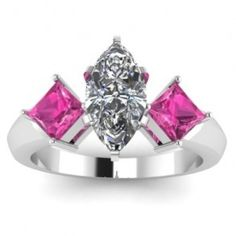 Marquise Princess Cut Pink Sapphire Diamond Engagement Ring - Here's a beautiful three stone style 14k White Gold Marquise Princess Cut Pink Sapphire Diamond Engagement Ring that features a White Marquise cut center stone with two Princess cut Pink Sapphire accent side stones. This Marquise Princess Pink Sapphire engagement ring comes with an SI1 in clarity with an E in color & the total gem weight is equal to .70 carats. All of the diamonds are 100% natural. #unusualengagementrings
