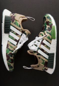 "Detailed photos of the BAPE x adidas NMD R1 collaboration have finally surfaced, and the release is looking to be another instant classic in the history of streetwear collaborations. Arriving in two seperate colorways of ""Green Camo"" and ""Purple Camo,"" A Bathing Ape's famous ape camo motif can be found on the uppers of both pairs. …"