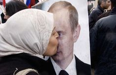 A Syrian woman kisses a photo of Russian Prime Minister Vladimir Putin during a pro-Syrian regime protest in front of the Russian embassy in Damascus, Syria, on March 2012 Vladimir Putin, The Middle, Middle East, Syria News, Globe News, Cult Of Personality, Turkish Army, Learn Russian, Foreign Policy