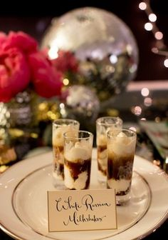 White Russian Milkshakes: tiny scoops of vanilla ice cream topped with vodka, kahlua and a dash of cream.
