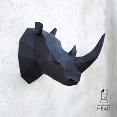 With this template, you can make your own paper rhino head! Size: 7 pages, 30 parts Difficulty level: medium/high The dimensions of the assembled sculpture (cm): H30 W35 D15 when printing on A4 or H40 W50 D20 when printing on A3 The product contains the following files in .pdf