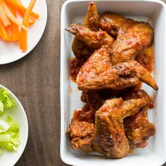 Garlicky Chicken Wings   These sticky, crispy chicken wings have a nice kick, thanks to a simple chile-garlic glaze.