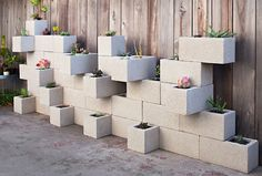 Concrete block garden wall. Brilliant clean lines, but with texture and interest.