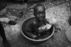 This picture shows how sad the population was after the earthquake in Haiti. Damon Winter, the New York Times, after the Haitian earthquake Clint Eastwood, Black White Photos, Black And White Photography, New York Times, Still Photography, Photography Ideas, Magnum, Interesting Faces, Damon