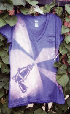 DIY graphic tee with bleach! Place a cut-out on a shirt and then spray bleach around it.