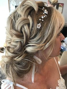 Loose updo with braids.