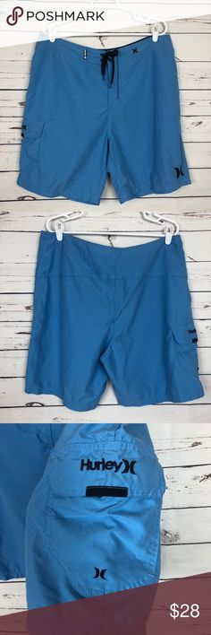 Hurley Board Shorts Swim Trunks Cargo Surf Skate Hurley Board Shorts Cargo Pocket Tie Waist Rubber Logo   100% Polyester  Size 36 Waist 36in Length 21in Leg Opening 25in  *preowned, with some wear* Hurley Swim Board Shorts