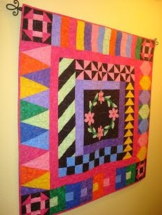 I loved the quilt for 2006. The fabric was beautiful and it had a lot of traditional blocks. But it also had some new techniques like a block with folded flowers