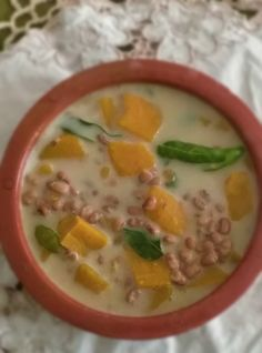 Olan - Yellow Pumpkin And Red Cowpeas In Coconut Milk Recipe. Olan, a simple dish with very few ingredients from Kerala, is prepared with ash gourd (white pu...