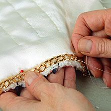 Inside a Chanel Jacket. Each one is a work of art. If it doesn't have this chain, then it's not a real Chanel.
