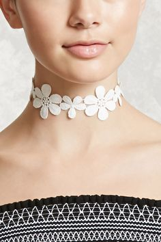A crochet choker featuring a floral design and a lobster clasp closure.