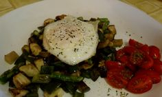 Veggie hash - aspar.poblano. egg plant - topped with oe egg with cherry tomatoes with celentro