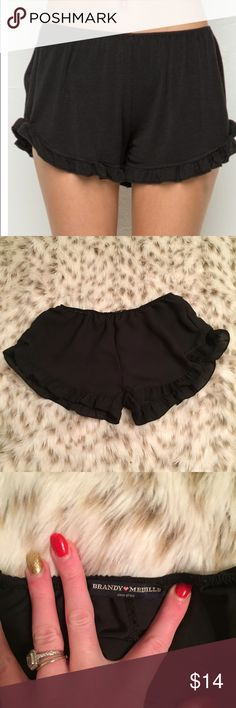 Brandy Melville Vodi Ruffle Shorts Brandy Melville one size black Ruffle vodi shorts! Too cute! No flaws! One size (fits small to medium) these are not cotton they are more polyester it's silky and soft Brandy Melville Shorts