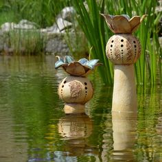 Blooming Pod Sculpture in water - Pond life.