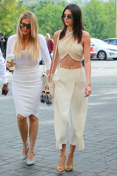 Kendall Jenner and Khloé Kardashian arrive at church for Easter in Los Angeles on April 5, 2015.   - Cosmopolitan.com