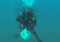 Human bones found on seabed may have been used in recent religious ritual. A Guardia Civil diver with one of the bundles of human remains