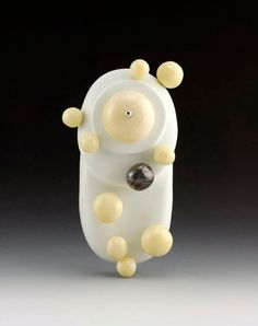 """Emily Watson. Brooch: Carbonated Ivory, 2012. Faux bone, simulated ivory, metal composite, silver. 3"""" x 1.25"""" x .5""""."""