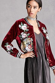 A knit velour bomber jacket featuring floral patches on the front and sleeves, front tiger patches, a zip front, on-seam pockets, and striped ribbed knit trim. This is an independent brand and not a Forever 21 branded item.