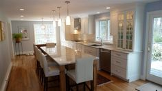 Long narrow kitchen - if we removed wall of cabinets and added island/bar. long blank wall behind seats