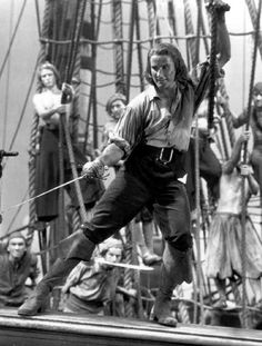 Captain Blood - Errol Flynn (my father was an extra on this movie, until they asked him to climb the rigging. He said no, and that was the last of his Hollywood career) Golden Age Of Hollywood, Vintage Hollywood, Classic Hollywood, Errol Flynn, Old Movies, Great Movies, Indie Movies, Comedy Movies, Vintage Movies