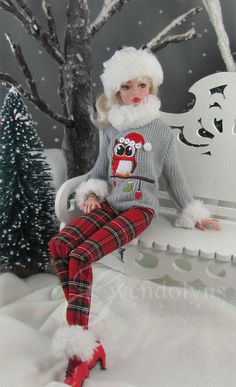 Festive Owl embroidered Christmas sweater with pompom hat, faux fur cuff and collar. It is paired with matching plaid cotton pocketed straight leg pants pants, removable fur boot cuffs and a fur trimmed white knit slouch hat. Snap back closure. Pants can be ordered in 2 lengths: