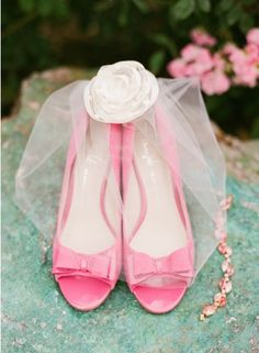 Pink heels and birdcage veil. Photo by Taylor Lord Photography. www.wedsociety.com #wedding #shoes