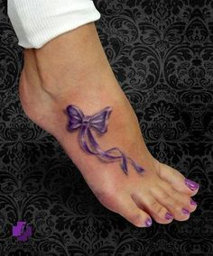 ribbon tattoo on foot - 50 Awesome Foot Tattoo Designs | Art and Design