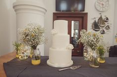 Three tier iced wedding cake with fondant white roses | Photography by http://www.rebeccadouglas.co.uk/blog/