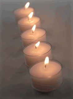 Tealights Candles in clear cups (50 tealights) - $8.40  Burn for 4-5 hours. The clear cup on these looks better than the metal casing on other tealights.