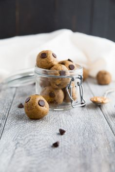 Healthy Cookie Dough Peanut Butter Protein Balls 3/4 cup all natural drippy peanut butter (any nut butter will work) 1 tablespoon coconut flour, plus more if necessary 1/2 cup protein powder  1 teaspoon vanilla extract 1 tablespoon unsweetened almond milk, plus more if necessary 2 tablespoons chocolate chips - optional