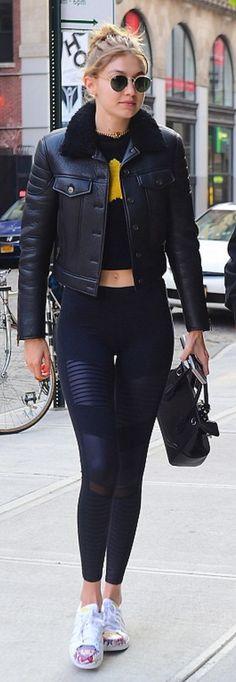 Who made Gigi Hadid's leggings, round sunglasses, white sneakers, and handbag?