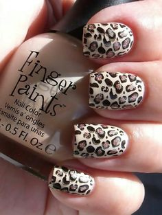I would do dark brown and one leopard nail (: