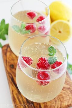 Limoncello Raspberry Prosecco Cooler – Kick back and relax with a sparkling summery sip... bubbly, lemony Prosecco with fresh raspberries and mint! | thecomfortofcooking.com