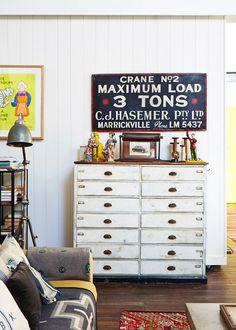 Vintage display and great industrial storage ~ clowns, bobbins, signs <3