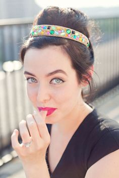 jeweled headband + bright makeup for a festive look