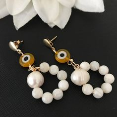 Handmade elegant and sophisticated earring with genuine pearls, evil eye and gold plated 18 carats.One of the kind. by PathysDesign on Etsy