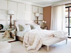 all white is so glam... loving the textured throw, paneled backdrop + mirrored side table